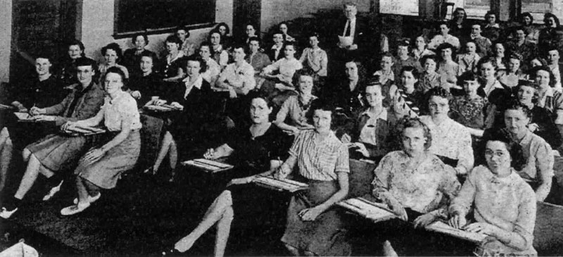 Mueller Co. women in a Millikin University classroom, 1943